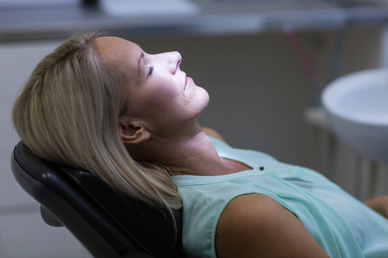 woman sedated at the dentist office